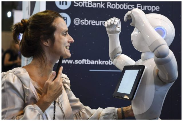 A woman plays with a robot at the Softbank Robotics exhibition stand during the VivaTech trade fair, on May 24, 2018 in Paris. / AFP PHOTO / ALAIN JOCARDALAIN JOCARD/AFP/Getty Images