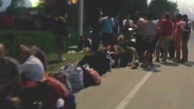Still from timelapse of migrants in a long queue waiting for transport at the Croatian border town of Tovarnik