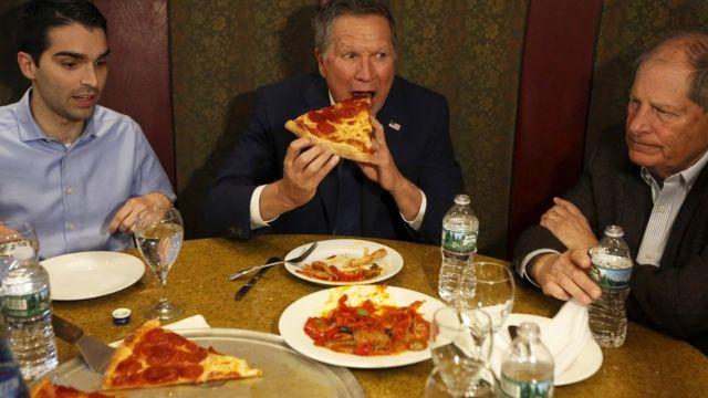 John Kasich eating pizza