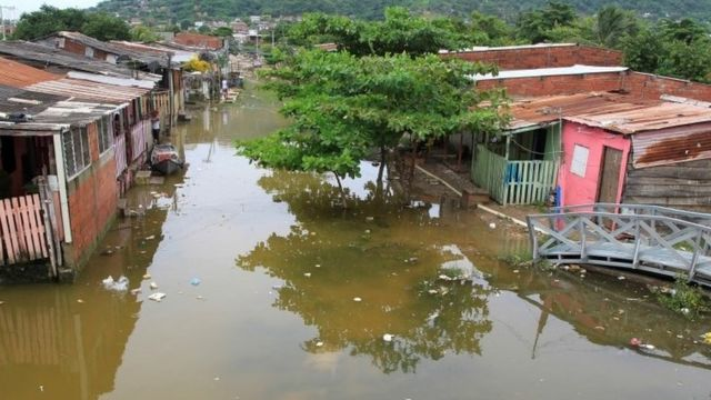 View of a flooded street in a low-income in Cartagena, Colombia. Photo: 15 November 2020