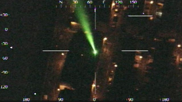 A laser shining towards a helicopter
