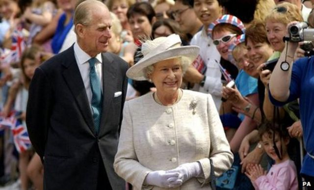Queen Elizabeth II and the Duke of Edinburgh greet crowds in the grounds of Windsor Castle, Berkshire, 2002