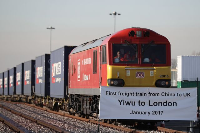 A train engine pulls carriages that started their Journey in Yiwu in China into Barking rail freight terminal on January 18, 2017 in Barking, England.
