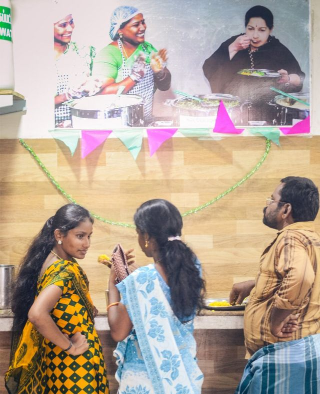 Diners below a Jayalalithaa poster