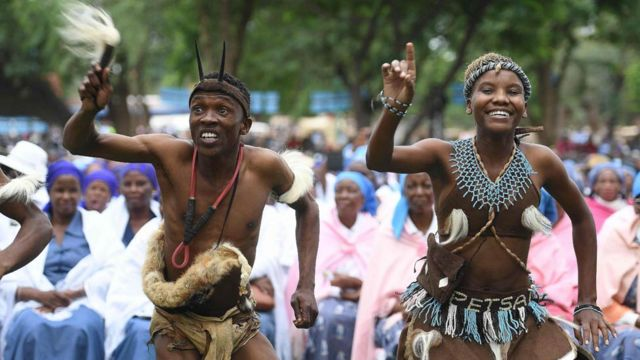 Traditional dancers perform as Botswana's President Seretse Ian Khama arrive at a rally in his village of Serowe on March 27, 2018