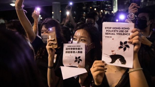 Protester holding up signs 'stop Hong Kong police's use of sexual violence'
