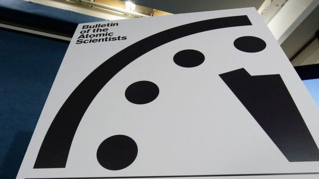 """A sign showing the """"Doomsday Clock"""" that remains at three minutes to midnight is seen after it was unveiled by the Bulletin of the Atomic Scientists, Tuesday, Jan. 26, 2016."""
