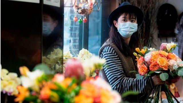 A florist in Shanghai arranges flowers