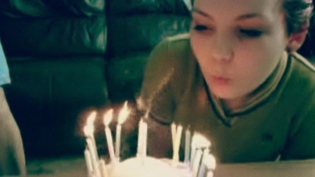 Sarah Green blowing out candles
