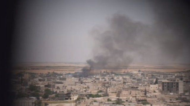 Smoke clouds hanging over the IS-held northern Syrian town of Manbij