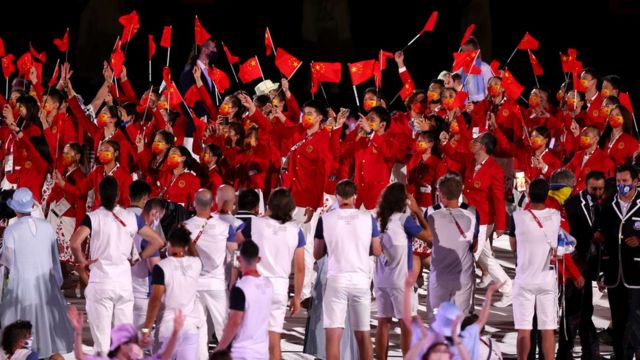 Members of Team China wave flags during the Opening Ceremony of the Tokyo 2020 Olympic Games at Olympic Stadium on July 23, 2021 in Tokyo, Japan.