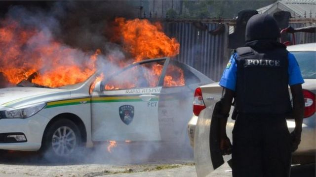 Shiite members burn police motor during protest.