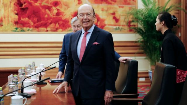 US Commerce Secretary Wilbur Ross (C) is accompanied by US Ambassador to China Terry Branstad as they arrive for a bilateral meeting with Chinese Vice Premier Wang Yang at the Zhongnanhai Leadership Compound in Beijing on September 25, 2017