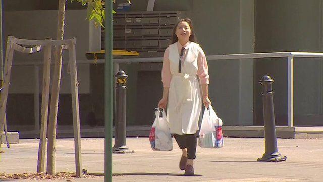 Rika Wenjing carrying shopping bags