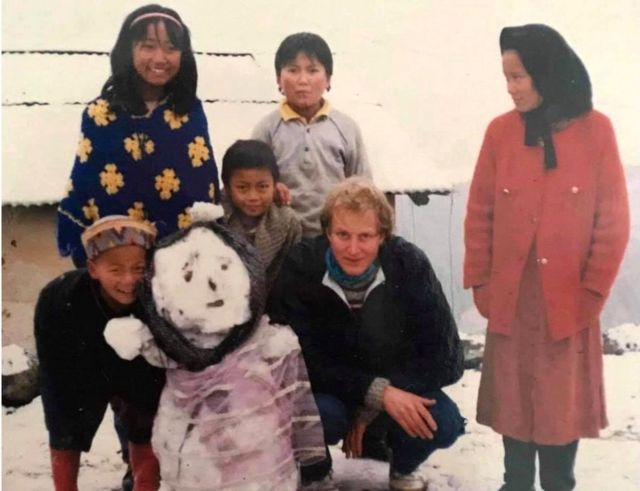 Reka (wearing headband) with her family when she was growing up in the in the Himalaya foothills