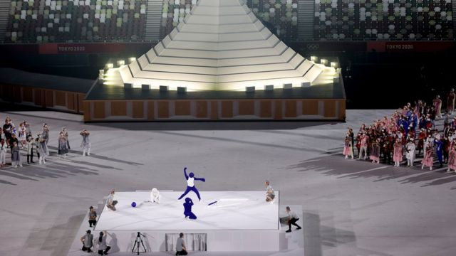 A performer dressed as a Pictogram acts out differnet Pictograms during the Opening Ceremony of the Tokyo 2020 Olympic Games at Olympic Stadium on July 23, 2021 in Tokyo, Japan.