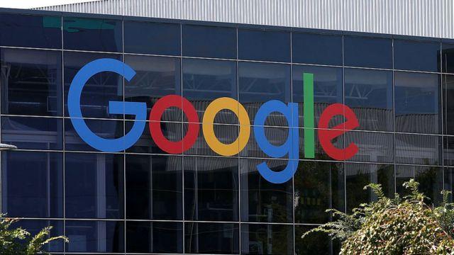 Google logo on top building