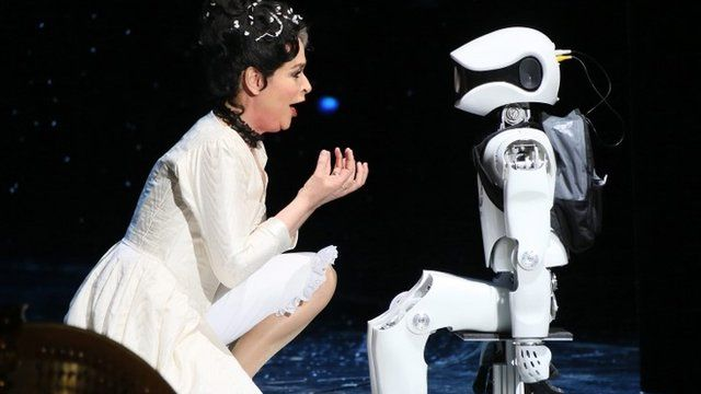 "Dutch mezzo-soprano Caren van Oijen performs with a robot named ""Myon"" during a rehearsal of the opera ""My Square Lady"""