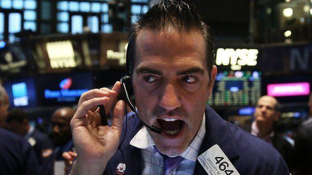 New York Stock Exchange trader talking over headset