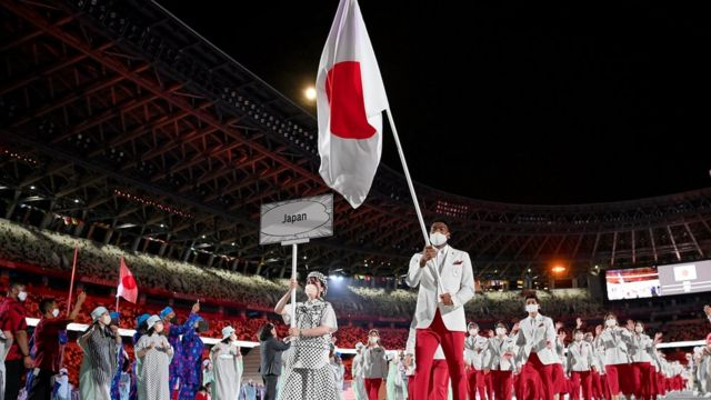 Flag bearers Yui Susaki and Rui Hachimura of Team Japan lead their team out during the Opening Ceremony of the Tokyo 2020 Olympic Games at Olympic Stadium on July 23, 2021 in Tokyo, Japan.