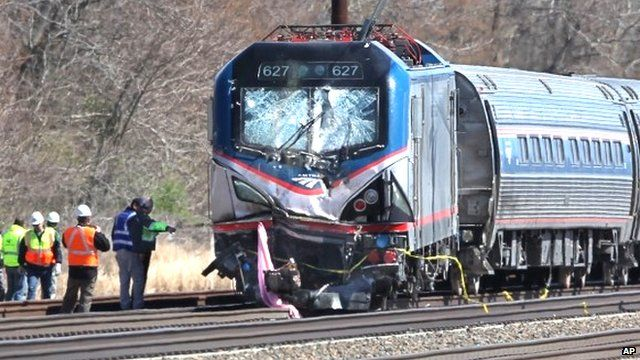 Amtrak investigators inspect the train