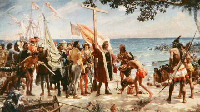 Una pintura muestra la llegada de Colón en una de las islas del Caribe.
