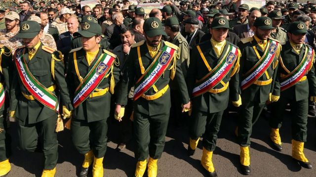 Members of the Iranian Revolutionary Guard carry the casket of Iran's Revolutionary Guards Brigadier General Mohsen Ghajarian, who was killed in the northern province of Aleppo by jihadists in Syria, during their funeral procession in the capital Tehran, on February 6, 2016.