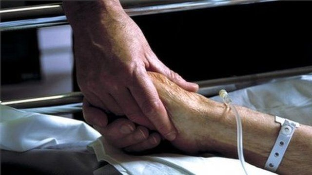 Nurse and patient holding hands