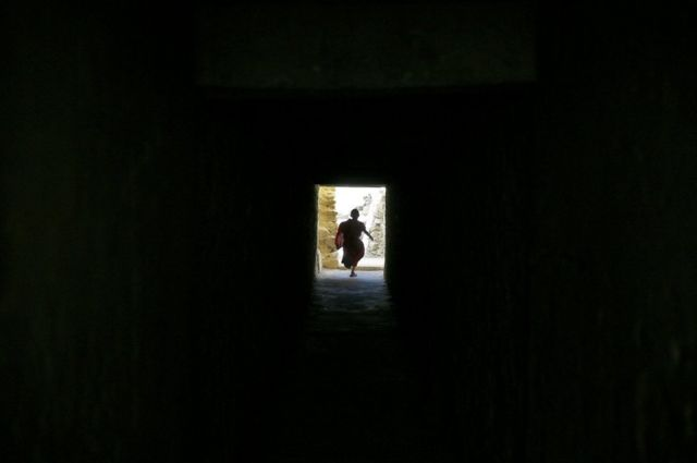 A young monk runs during a break from his studies inside Thiksey Monastery in Ladakh, India.