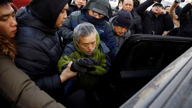 A supporter of prominent rights lawyer Wang Quanzhang is detained outside the courthouse where his trial is held, in Tianjin, China December 26, 2018.