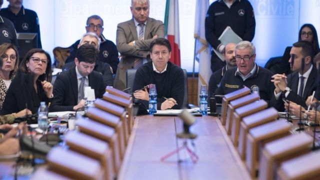 Italian Prime Minister Giuseppe Conte chairing an emergency meeting