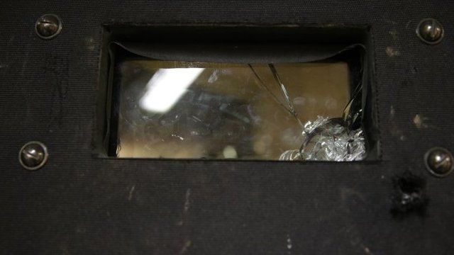 A bullet-hole riddled riot shield which was used during the assault at the Bataclan threatre