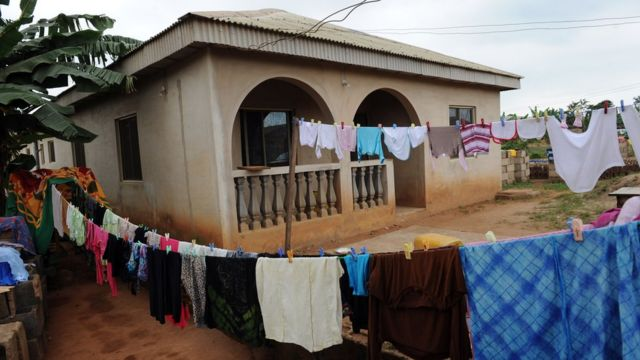 Clothes hang outside pesin bungalow house.