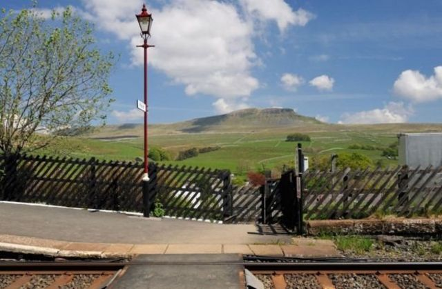 The Pennine-way footpath to Pen-y-ghent crosses the rail track at Horton in Ribblesdale, close to where the walkers began their trek