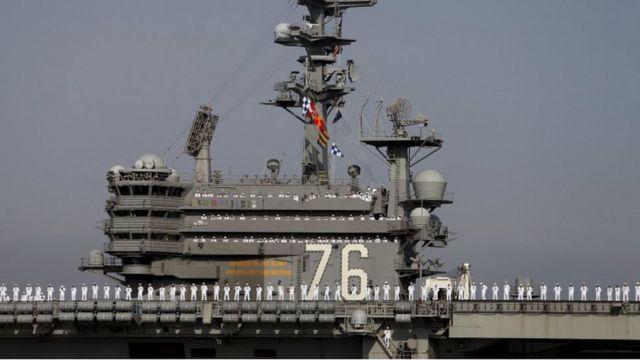 The crew members of the USS Ronald Reagan