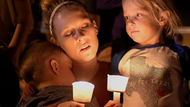 A woman and her children take part in a vigil for victims of a mass shooting in Sutherland Springs, Texas, US., November 5, 2017.