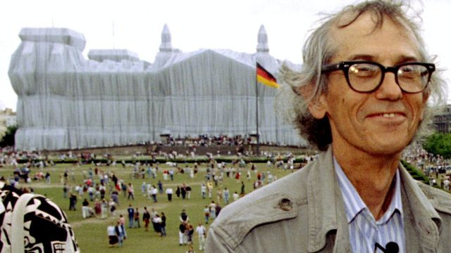 Conceptual artist Christo poses for photographers in front of the wrapped Reichstag, 26 June 1995