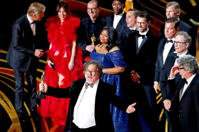 Green Book producer Charles Wessler spoke on stage alongside director Peter Farrelly (right) and cast and crew after the film won the top award, best picture