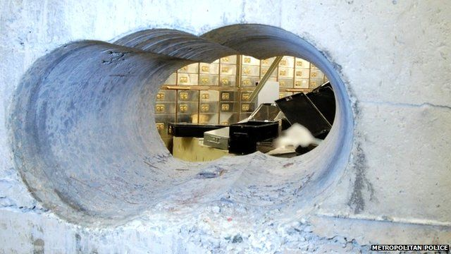 Tunnel drilled through vault wall