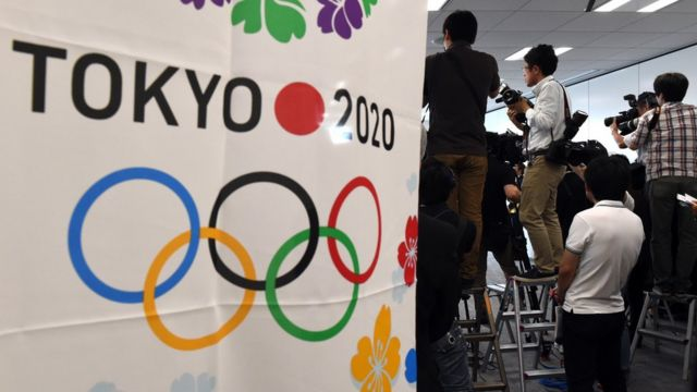 Photographers take pictures during a panel at the Tokyo 2020 organising committee headquarters in Tokyo