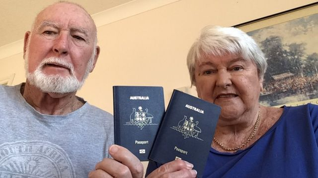 John and Margaret Sparks hold up their Australian passports