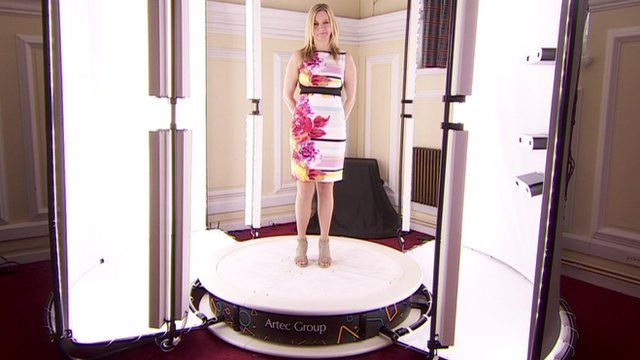 Kate Russell standing in a 3D scanner
