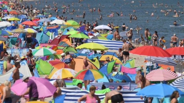 People crowd a beach on the island of Usedom, northern Germany
