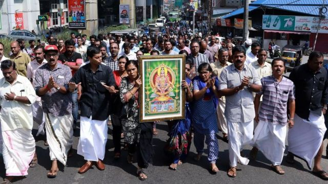 India protesters carry a picture of the Hindu deity Ayyappa at a demonstration following the entry of two women at the Sabarimala temple, in Kochi in southern Kerala state on January 2, 2019.