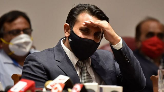 Adar Poonawala with a face mask at a press conference in January.