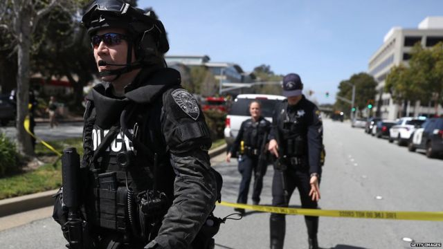 Law enforcement stands watch outside of the YouTube headquarters on April 3, 2018 in San Bruno, California.