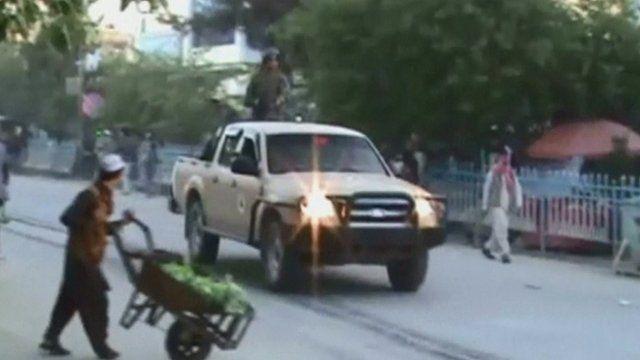 Man crossing road on Kunduz city street