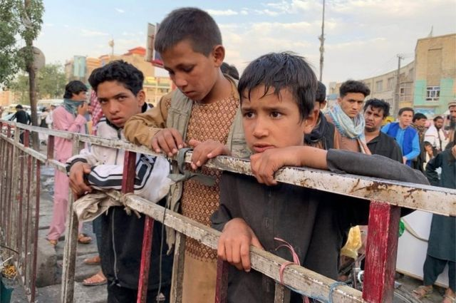 Afghan people gather at the scene after a bomb explosion in Kabul, Afghanistan, 13 July 2021.
