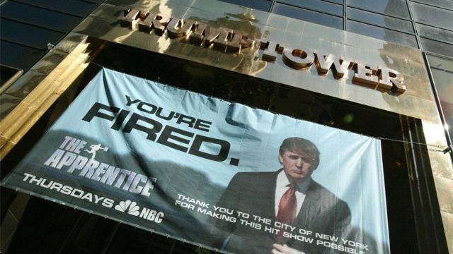 A advert for The Apprentice hung at Trump Tower