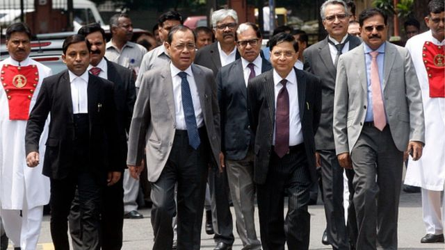 Former Indian Chief Justices Dipak Misra and Ranjan Gogoi with other judges at an event in 2018